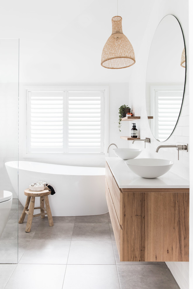 Example of a trendy master white tile and porcelain tile porcelain tile, gray floor and double-sink bathroom design in Sydney with flat-panel cabinets, medium tone wood cabinets, a one-piece toilet, white walls, a vessel sink, white countertops, quartz countertops and a floating vanity