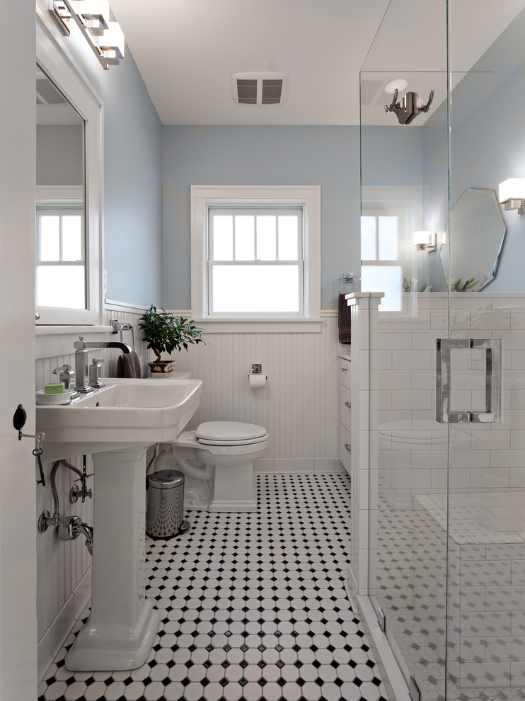 Inspiration for a victorian white tile and subway tile ceramic tile and multicolored floor bathroom remodel in Other with a pedestal sink, flat-panel cabinets, white cabinets, a two-piece toilet and blue walls