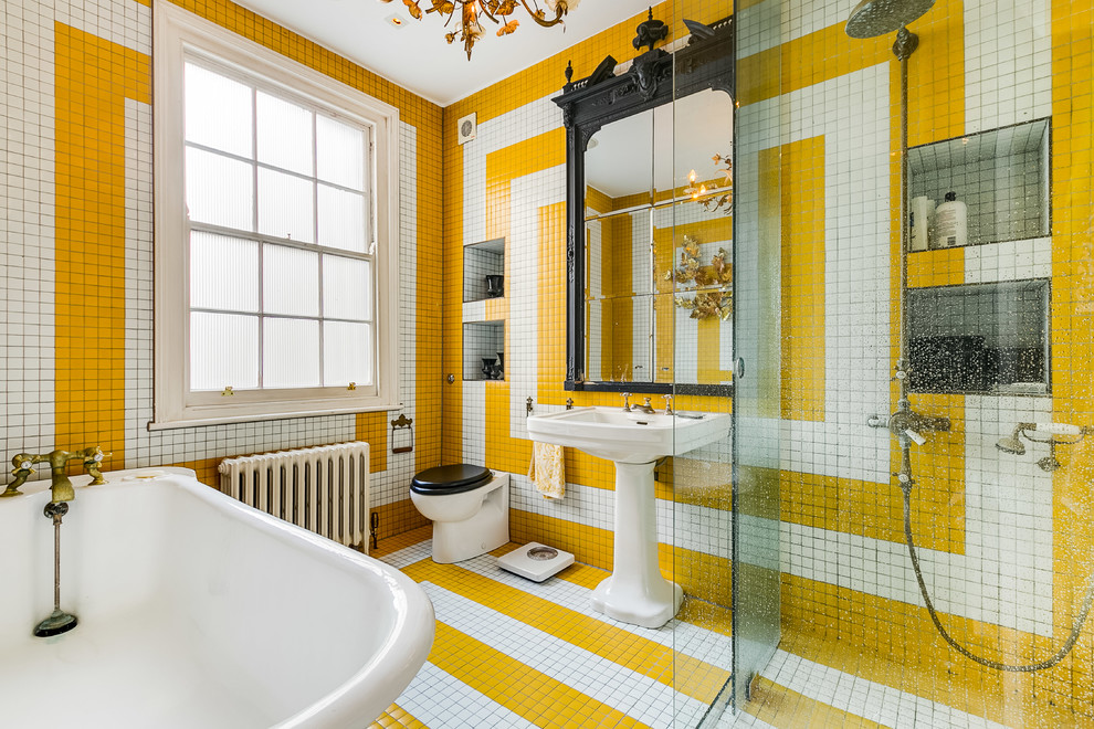 Example of an eclectic master multicolored tile, white tile, yellow tile and ceramic tile multicolored floor bathroom design in London with a wall-mount toilet, multicolored walls and a pedestal sink