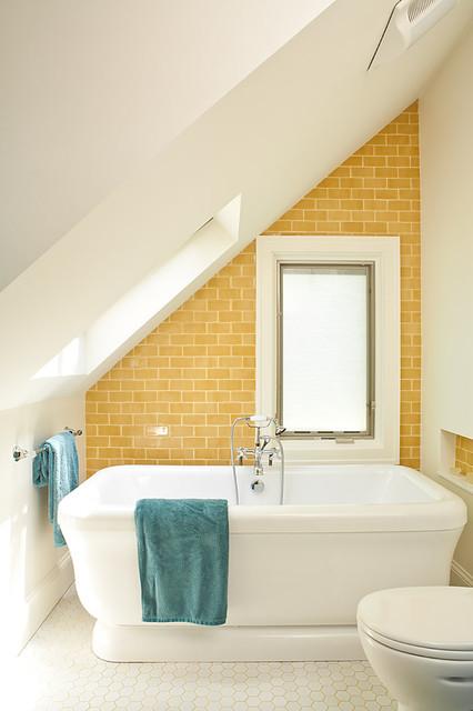 Coastal subway tile and yellow tile mosaic tile floor and white floor freestanding bathtub photo in Atlanta with yellow walls