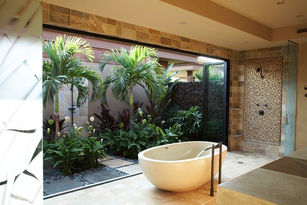Inspiration for a tropical mosaic tile freestanding bathtub remodel in Hawaii