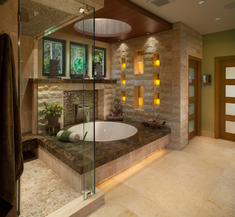 Example of a large zen master limestone tile marble floor corner shower design in San Diego with green walls and an undermount tub