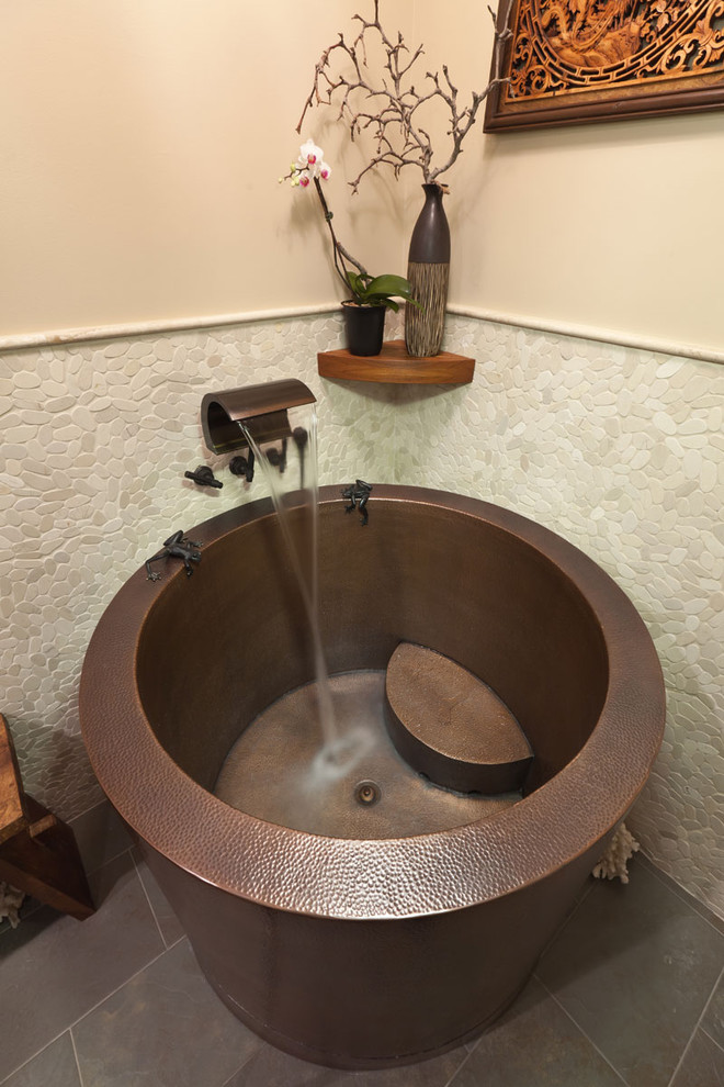 Japanese bathtub - asian beige tile and pebble tile japanese bathtub idea in Los Angeles