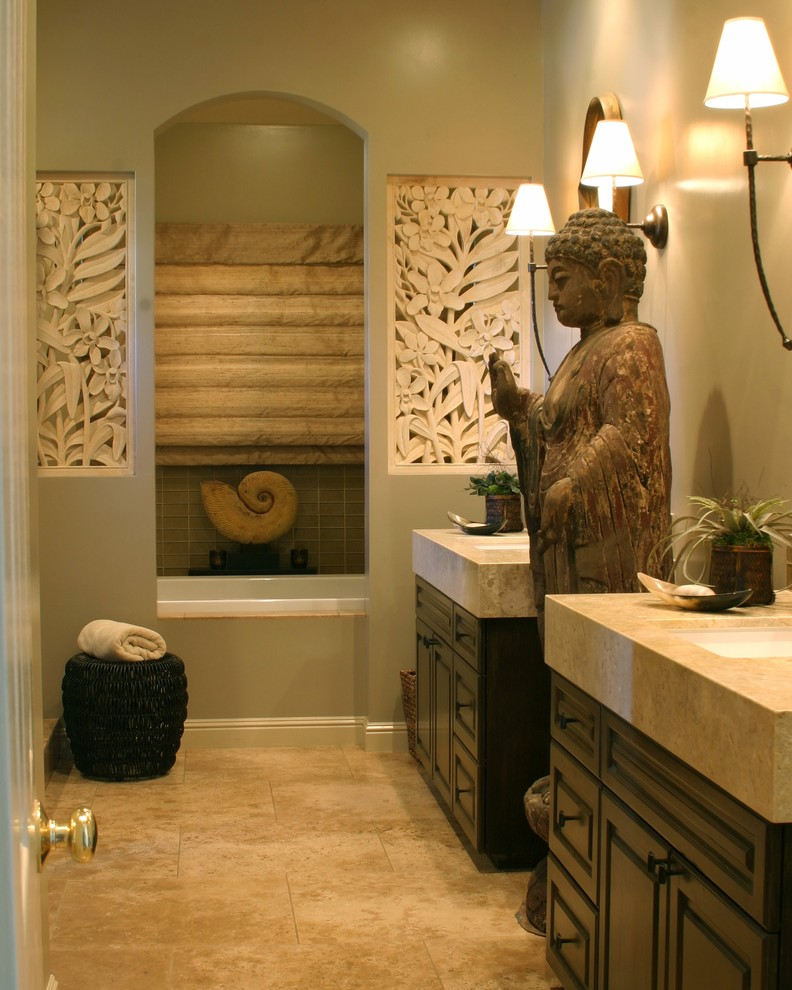 Bathroom - zen bathroom idea in San Francisco with limestone countertops and an undermount sink