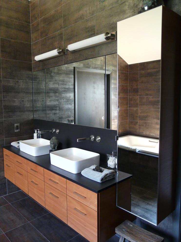 Bathroom - contemporary bathroom idea in Houston with a vessel sink