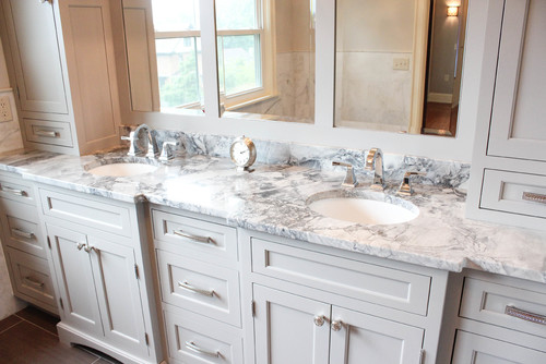 An elegant master bathroom remodel with duel his and her sinks, vanity towers and cabinetswith an off-white painted finish.