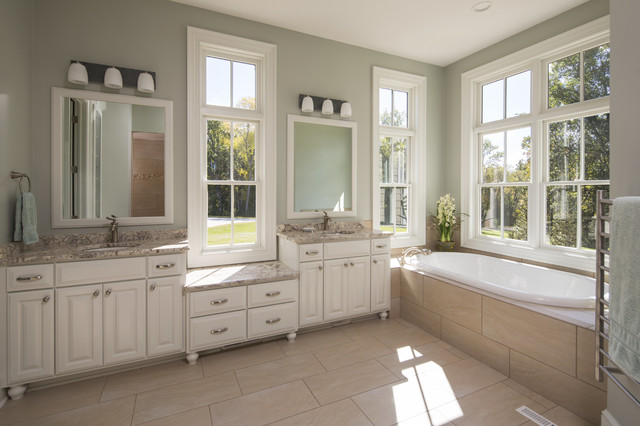 Example of a large classic master beige tile and porcelain tile porcelain floor bathroom design in Other with an undermount sink, raised-panel cabinets, white cabinets, granite countertops, a two-piece toilet and blue walls
