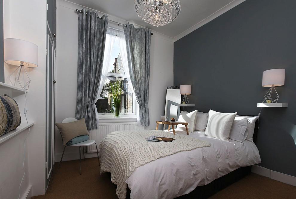 Bedroom - mid-sized contemporary brown floor bedroom idea in London