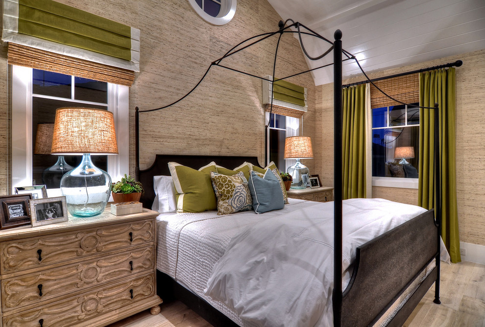 Inspiration for a timeless light wood floor bedroom remodel in Orange County with beige walls