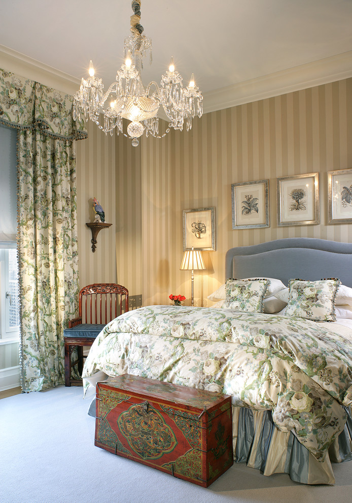 Ornate bedroom photo in New York with beige walls