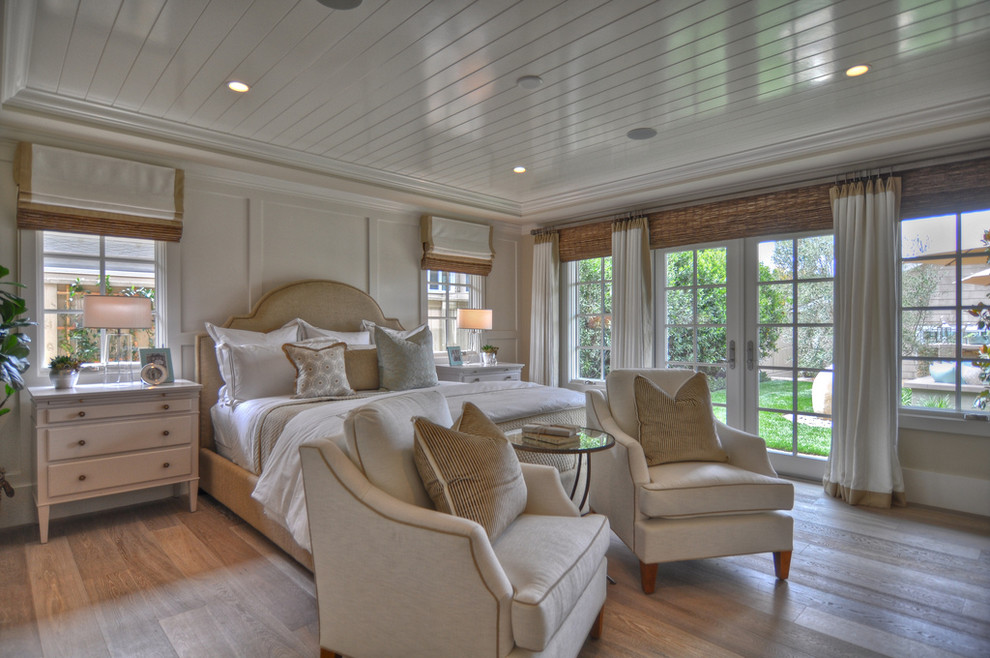Bedroom - coastal light wood floor bedroom idea in Los Angeles with white walls