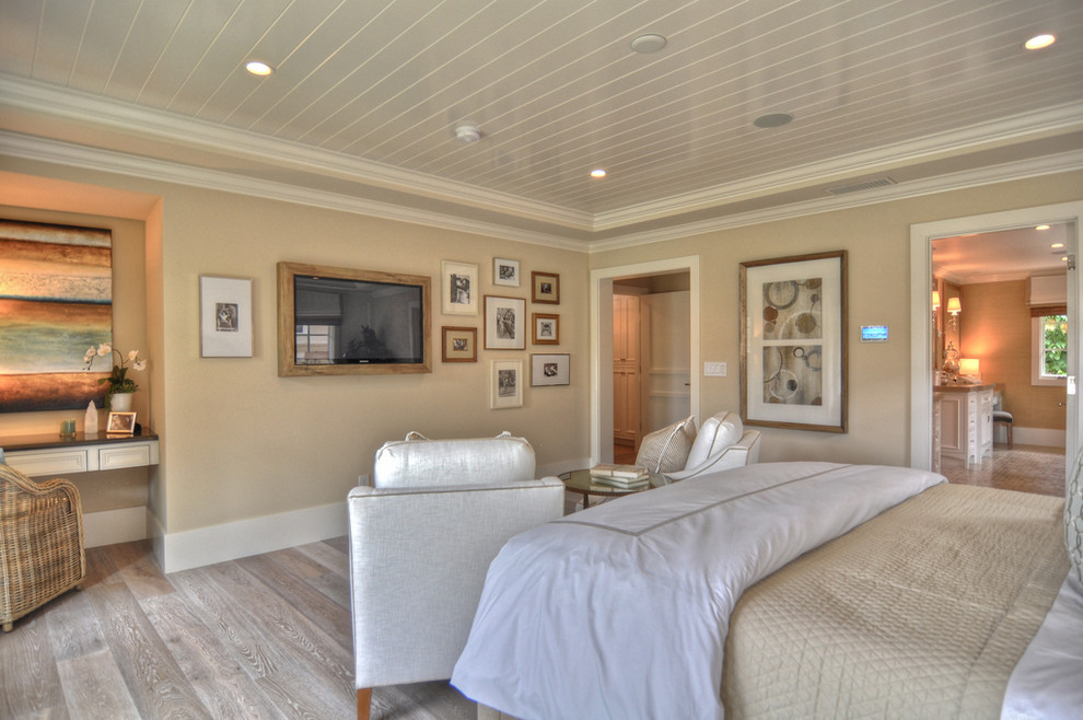 Example of a beach style bedroom design in Los Angeles with beige walls