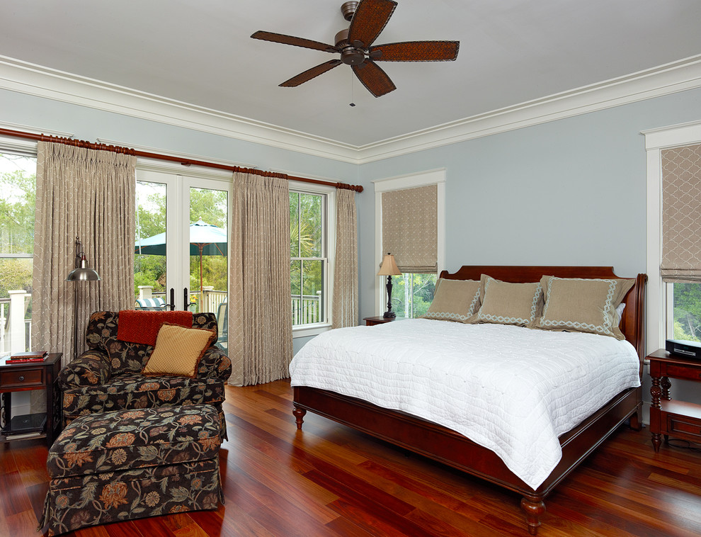 Inspiration for a timeless master bedroom remodel in Charleston with blue walls