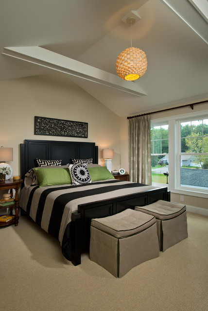 Inspiration for a mid-sized timeless master carpeted bedroom remodel in Boston with beige walls and no fireplace