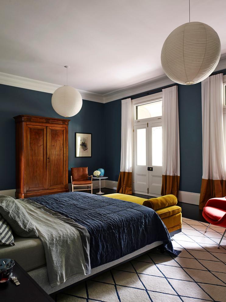 Trendy master dark wood floor bedroom photo in Sydney with blue walls