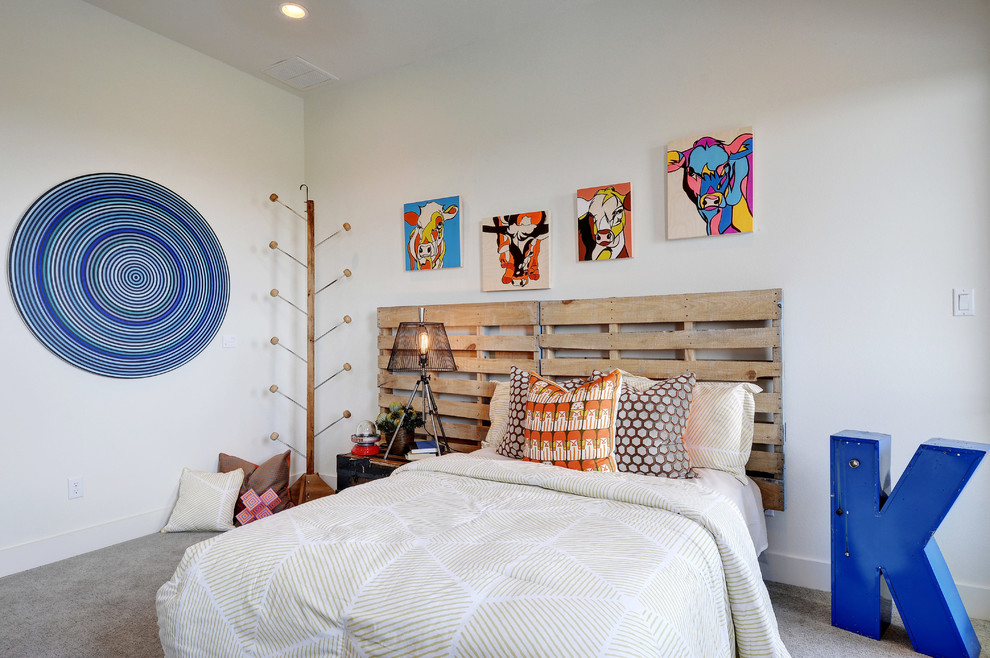 Inspiration for a mid-sized farmhouse guest carpeted bedroom remodel in Austin with white walls