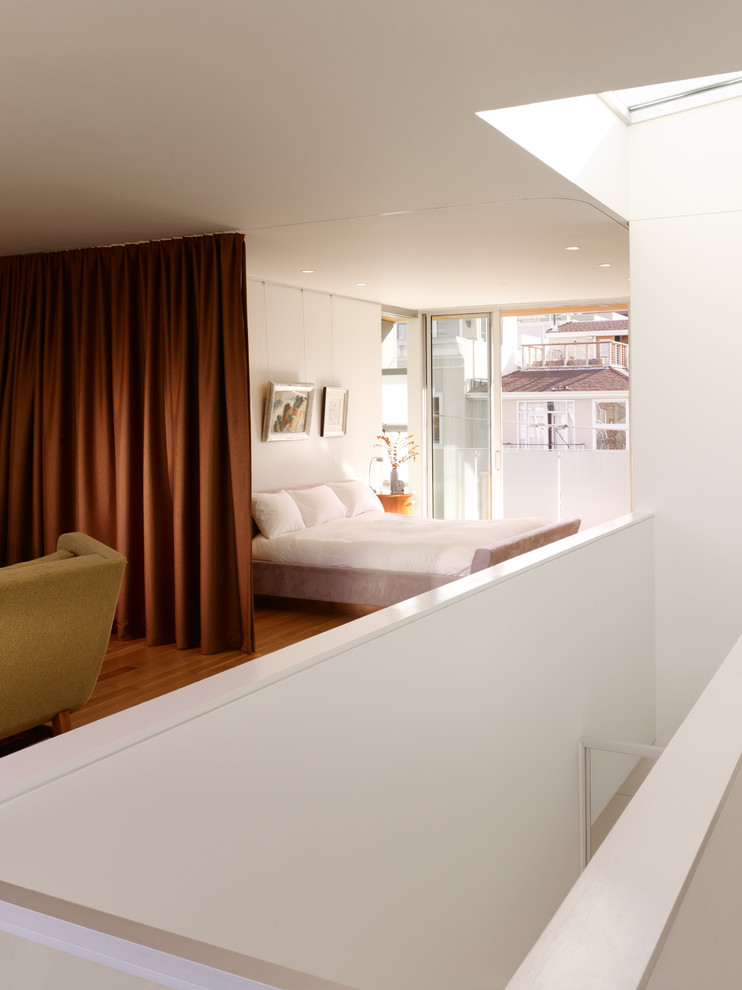 Example of a trendy loft-style bedroom design in San Francisco