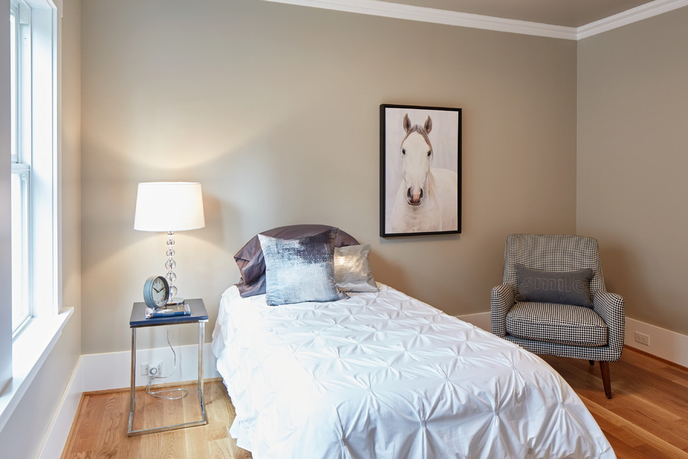 Mid-sized transitional guest light wood floor bedroom photo in Portland with gray walls