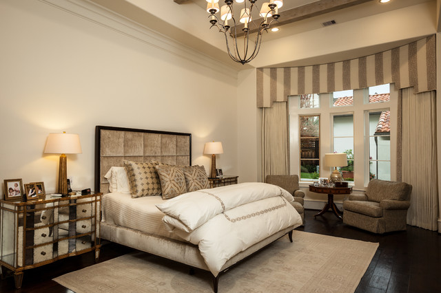 Large elegant master dark wood floor bedroom photo in Houston with beige walls and no fireplace