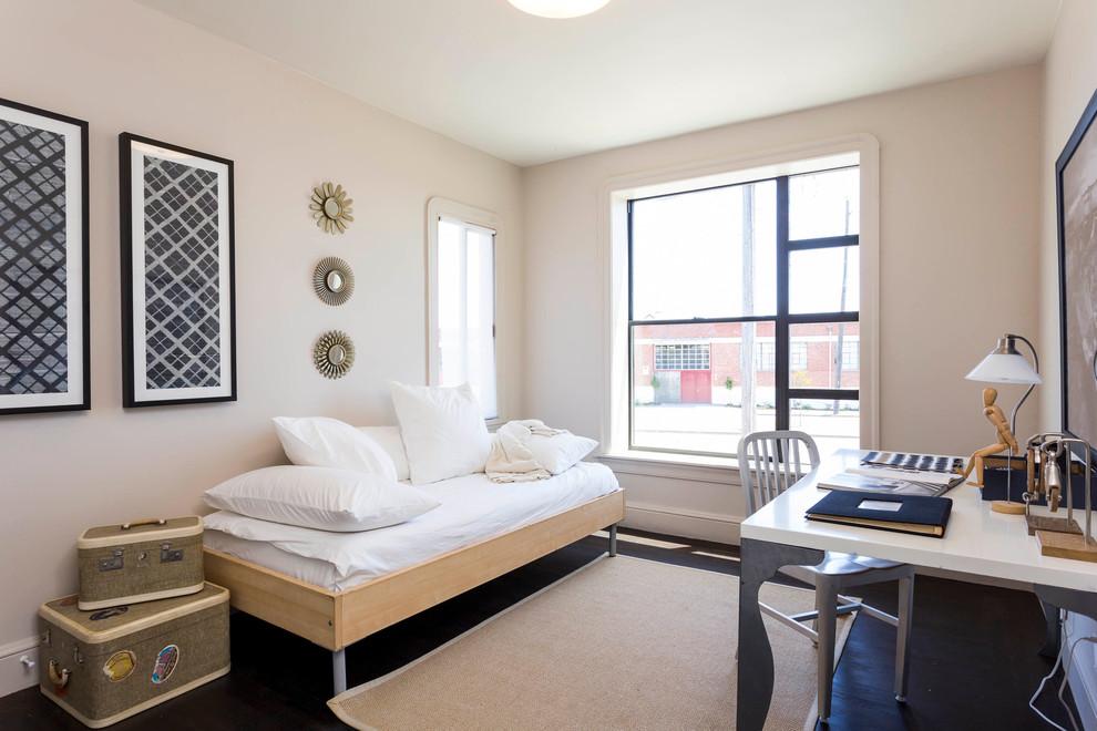 Example of a trendy dark wood floor bedroom design in San Francisco with beige walls
