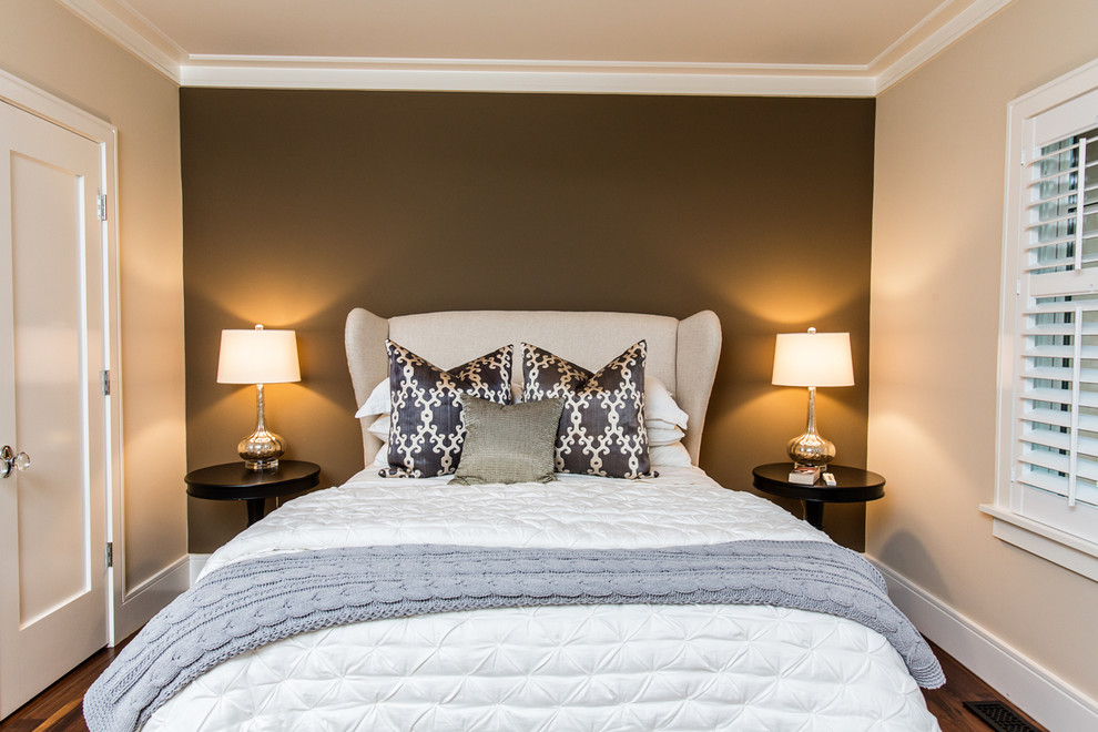 Example of a transitional bedroom design in Charleston with brown walls