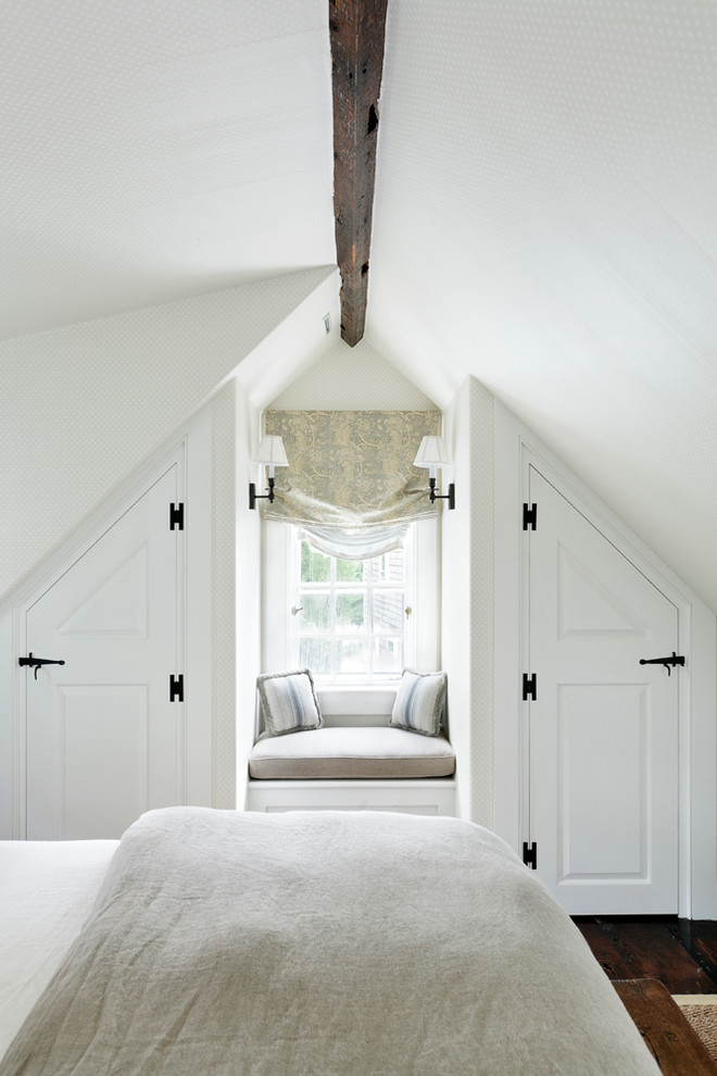 Example of a beach style dark wood floor bedroom design in Boston with white walls