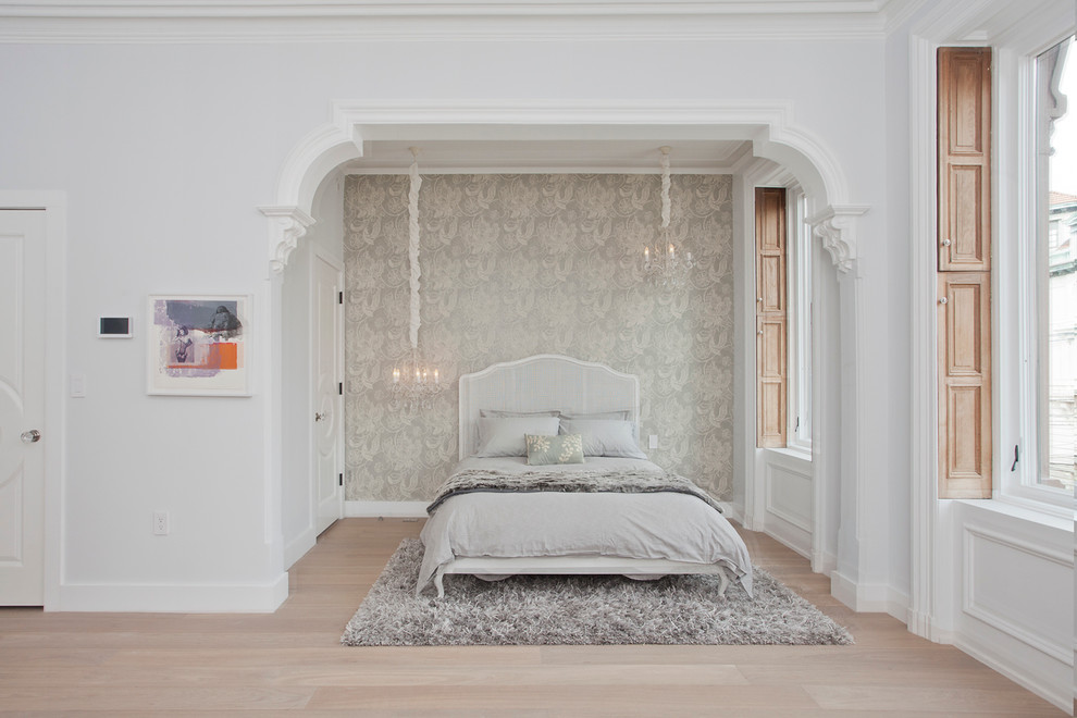 Inspiration for a large transitional master light wood floor bedroom remodel in New York with gray walls