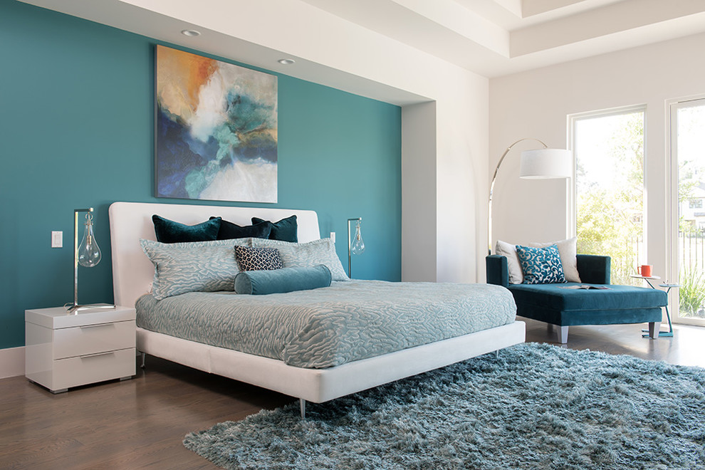 Example of a mid-sized trendy master bedroom design in Houston with blue walls