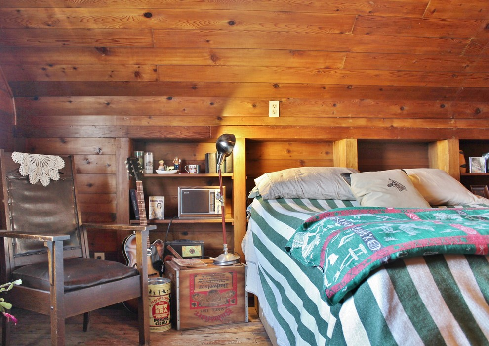 Example of an eclectic master medium tone wood floor bedroom design in Seattle