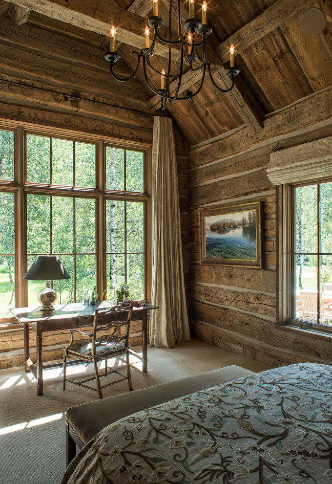 Inspiration for a mid-sized rustic master carpeted bedroom remodel in Other with brown walls