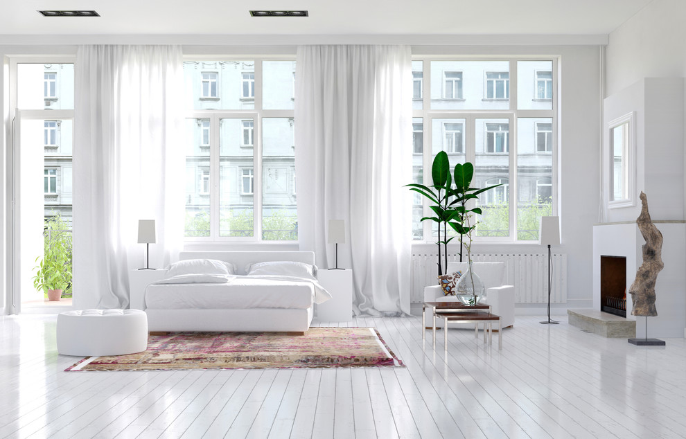 Large danish master painted wood floor and white floor bedroom photo in Miami with white walls, a standard fireplace and a plaster fireplace
