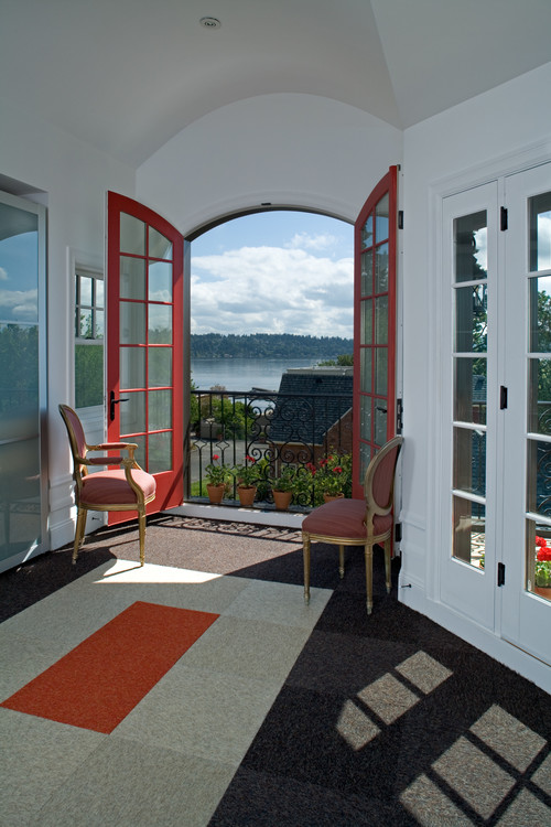A Juliet balcony adds light and warmth to a Seattle remodel.