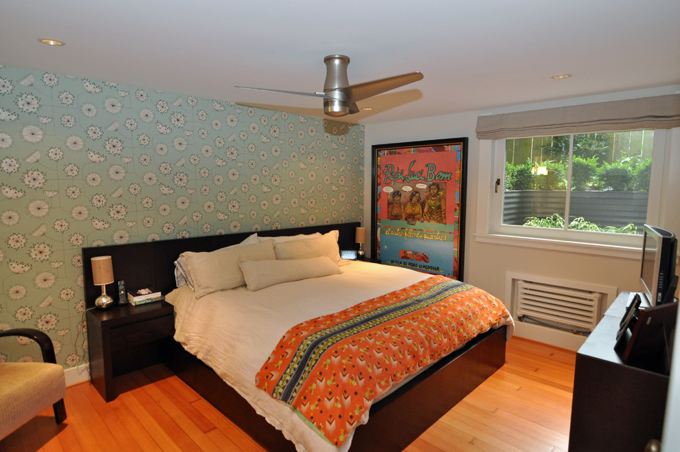 Inspiration for an eclectic medium tone wood floor and orange floor bedroom remodel in Seattle with blue walls