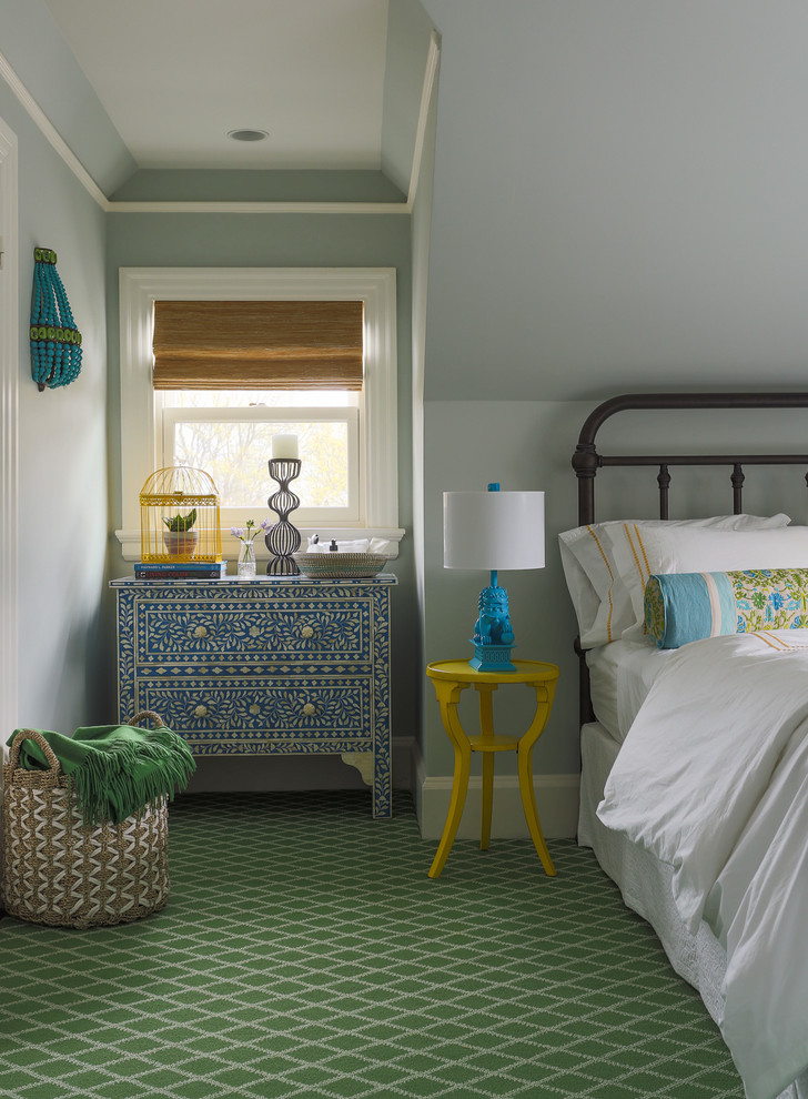 Inspiration for a mid-sized timeless guest carpeted and green floor bedroom remodel in Boston with blue walls
