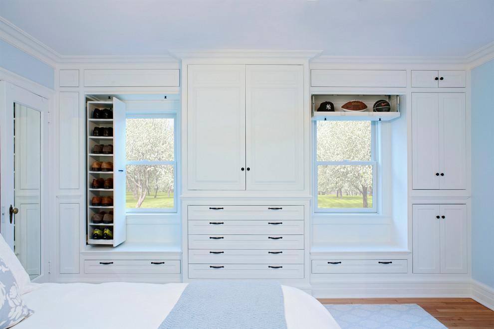 Bedroom - traditional medium tone wood floor bedroom idea in New York with blue walls
