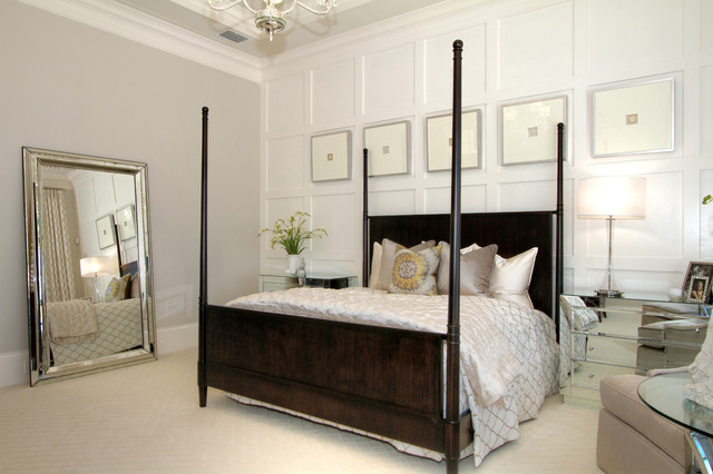 transitional master bedroom photo in tampa with beige walls and carpet