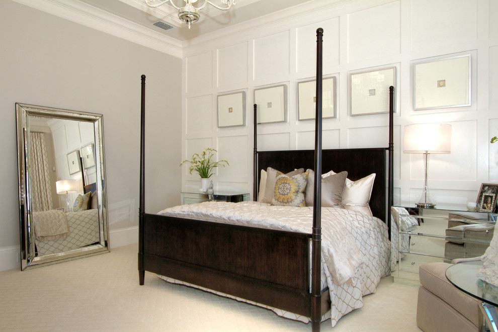 Transitional master carpeted bedroom photo in Tampa with beige walls