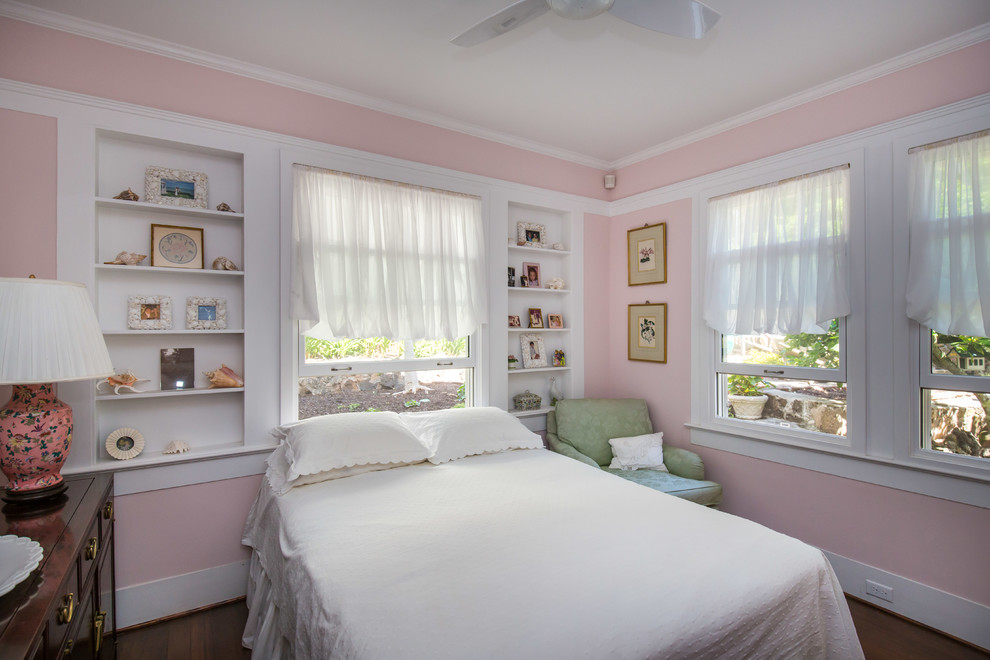 Bedroom - mid-sized traditional guest dark wood floor bedroom idea in Hawaii with pink walls