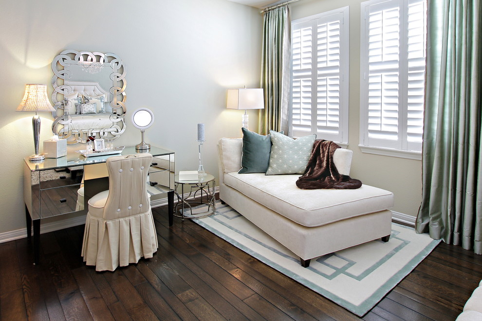 Inspiration for a contemporary dark wood floor bedroom remodel in Orange County with beige walls