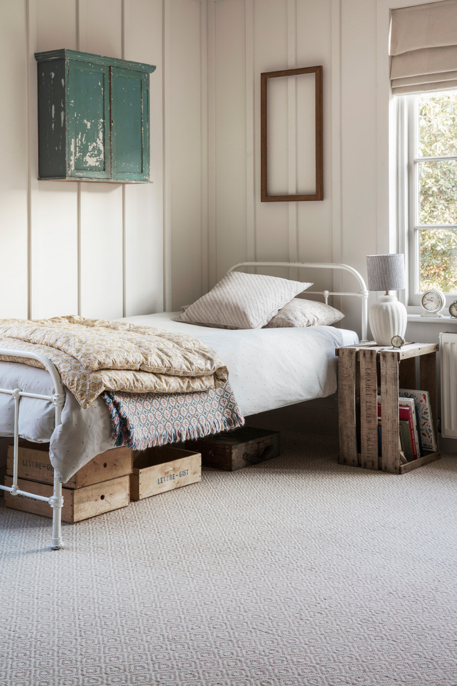Cottage chic carpeted bedroom photo in Hampshire with white walls