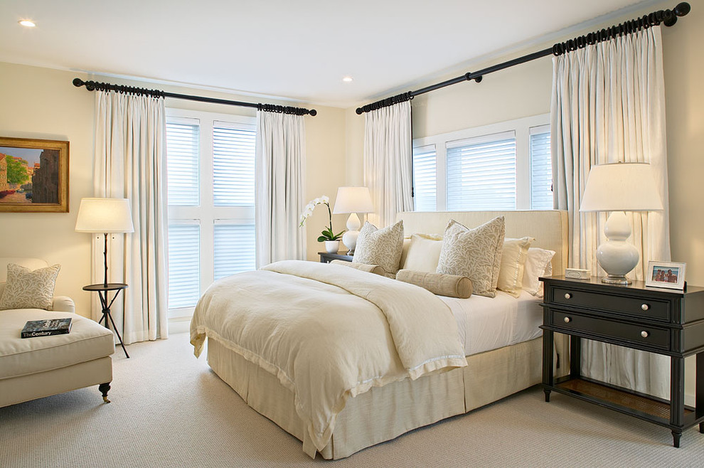 Elegant carpeted bedroom photo in New York with beige walls