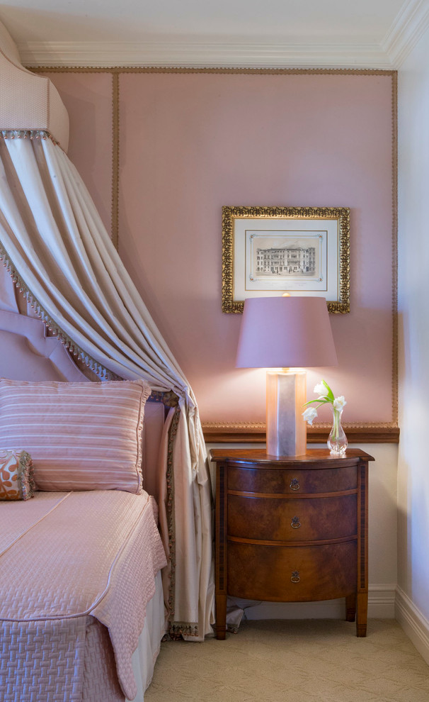 Example of a mid-sized classic guest carpeted bedroom design in Miami with pink walls