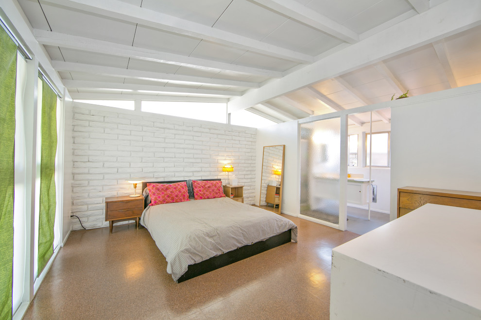Example of a mid-sized 1950s bedroom design in Orange County with white walls