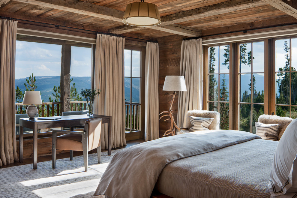 Example of a mountain style guest bedroom design in Other with brown walls and no fireplace