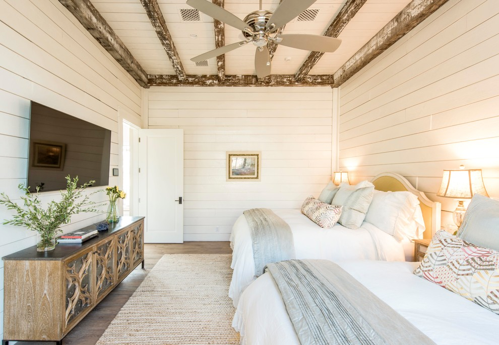Inspiration for a cottage guest dark wood floor bedroom remodel in Austin with white walls and no fireplace