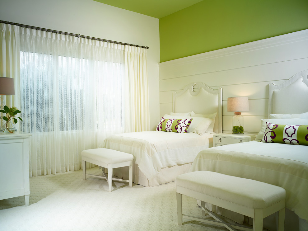 Bedroom - tropical guest carpeted bedroom idea in Miami with green walls