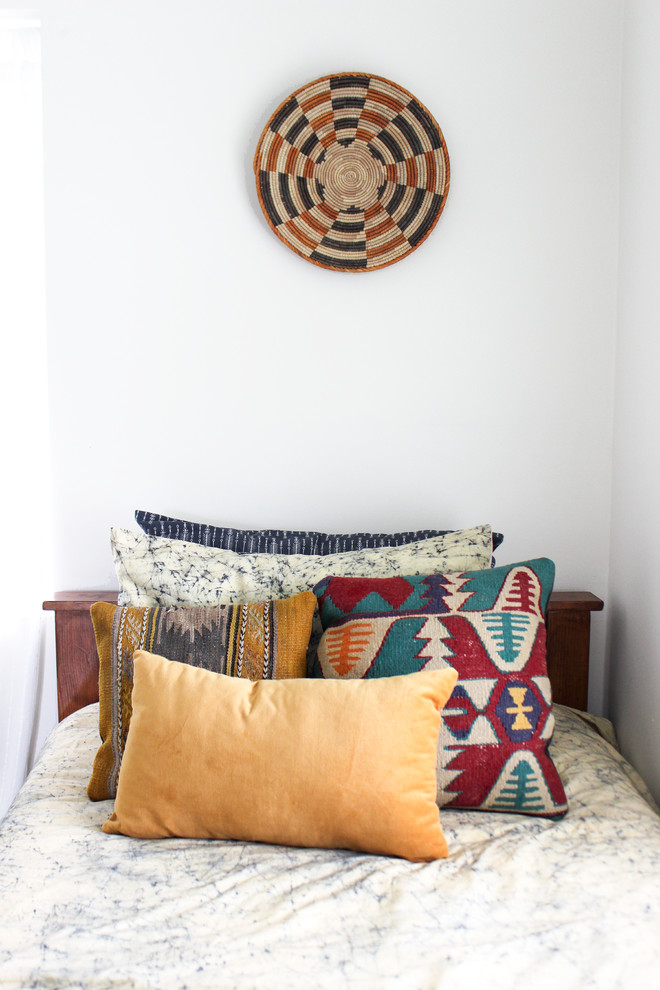 Example of a mid-sized eclectic bedroom design in Los Angeles with white walls