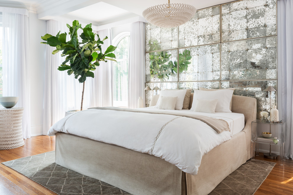 Inspiration for a large transitional master light wood floor bedroom remodel in Toronto with white walls, a standard fireplace and a tile fireplace