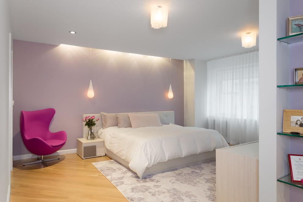 Bedroom - large modern guest light wood floor bedroom idea in New York with purple walls