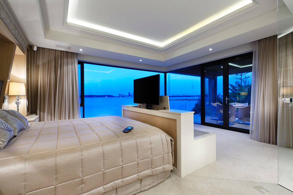 Bedroom - mid-sized contemporary master carpeted bedroom idea in Perth with beige walls